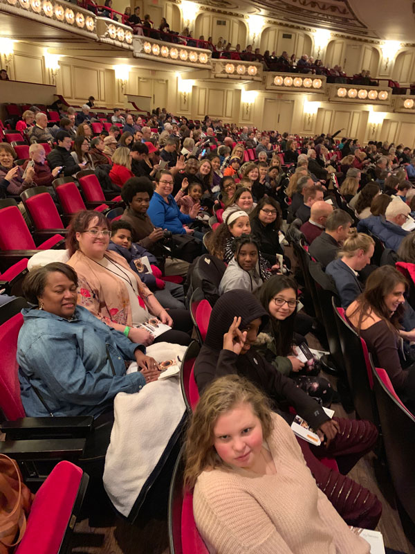Youth Art Team artists and chaperones seated and ready to take in the performance.